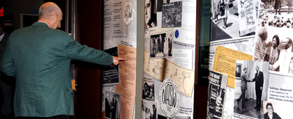 Guest Looking At Historic Photographic Display At 2015 NASW 60th Anniversary Celebration
